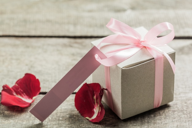 Roses and a hearts on wooden board, valentines day background
