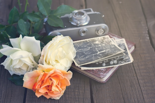 Roses and old family photos with camera