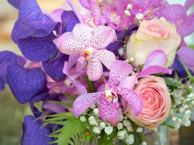 Roses and orchids decorated in beautiful bouquets.