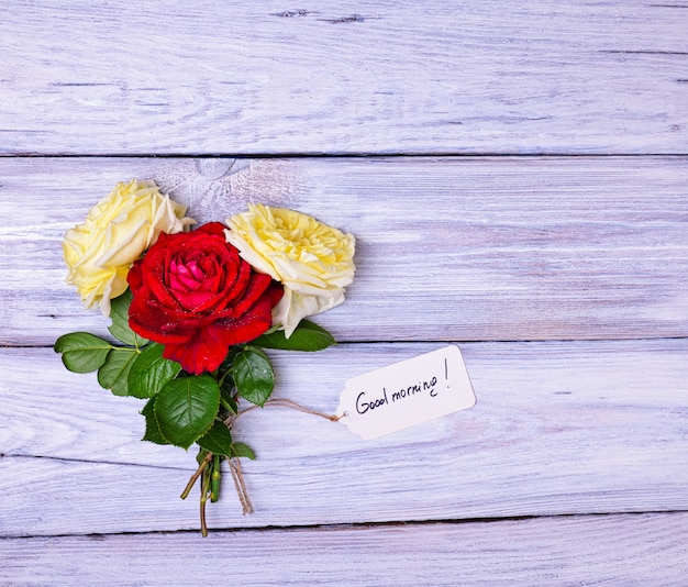 Roses and a paper tag with an inscription good morning
