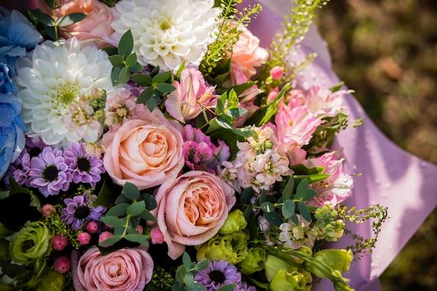 Roses, ranunculus, pumpkin hypericum, chrysanthemum. spring, summer floral arrangement