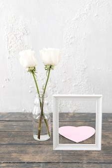 Roses in vase with frame and paper heart