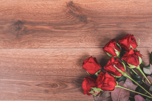 Roses on a wooden table