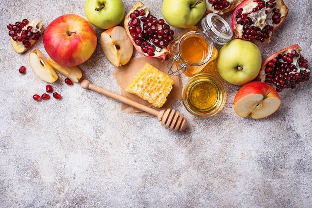 Rosh hashanaの蜂蜜、リンゴ、ザクロ