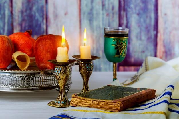 Rosh hashanah jewesh holiday concept shofar, torah book, honey
