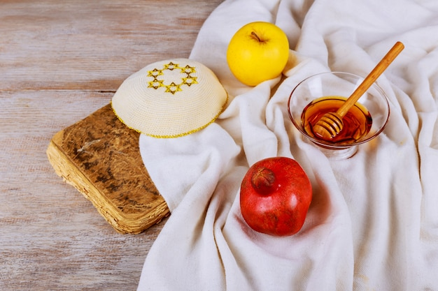 Rosh hashanah jewesh holiday shofar, torah book, honey, apple and pomegranate