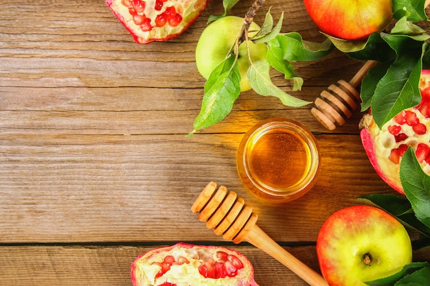 Rosh hashanah jewish new year holiday concept.  apples, honey, pomegranate. copy space. to