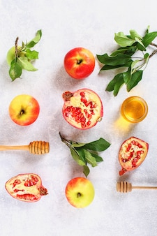 Rosh hashanah jewish new year holiday concept. apples, honey, pomegranate.