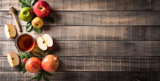 Rosh hashanah jewish new year holiday concept of traditional or religion symbols on old wooden background