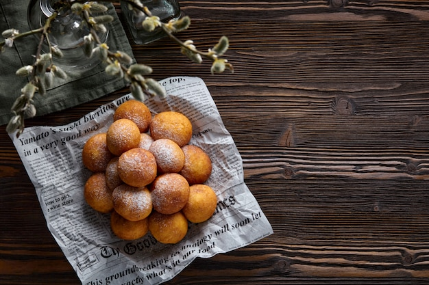 Rosy cheese balls on a dark wooden background. top view.