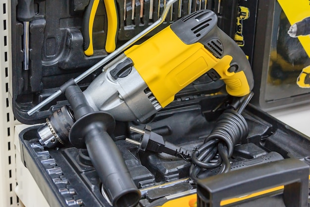 Rotary hammer with a hammer drill, screwdriver, electric cordless hand drill in the case