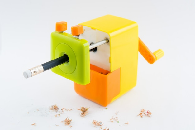 Rotary pencil sharpener and pencil isolated on white