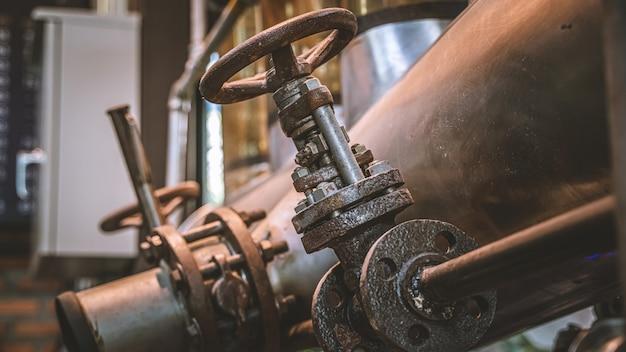 Rotating wheel coffee roaster equipment Premium Photo