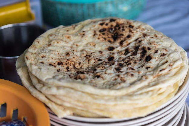 Roti, chapatti, nan or naan for sale at thai street food market or restaurant in thailand