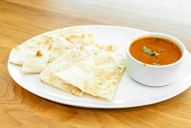 Roti with curry chicken soup