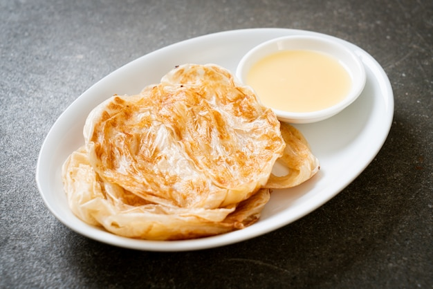 Roti with sweetened condensed milk (dessert)