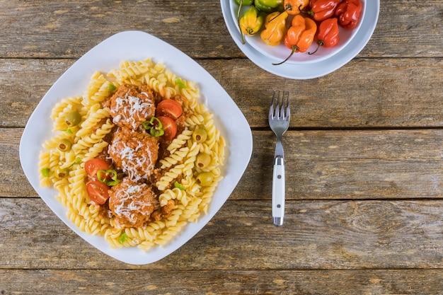 Rotini pasta with meatballs and italian tomato sauce