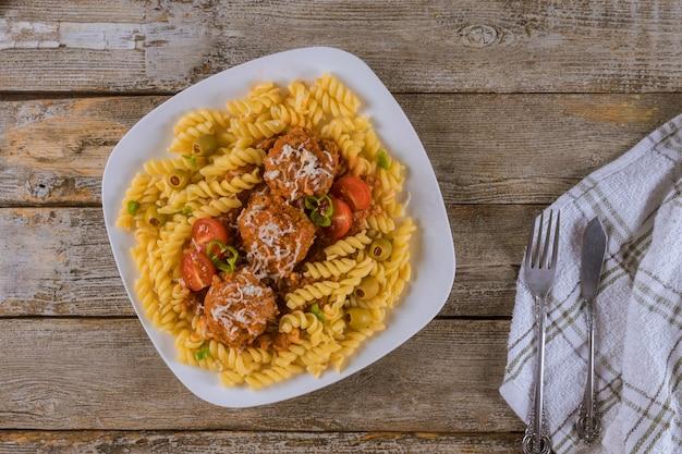 Rotini pasta with meatballs and marinara. top view