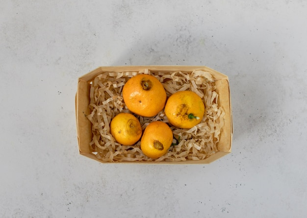 Rotten, spoiled, moldy tangerines, citrus fruits in a basket.