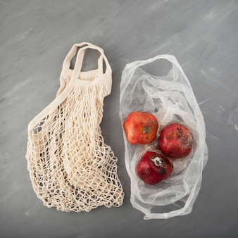 Rotten spoiled pomegranate with mold in disposable plastic bag