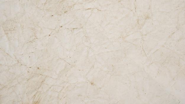ラフベージュの紙グランジ背景テクスチャデザイン