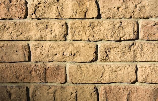 거친 벽돌 벽입니다. 질감 또는 배경