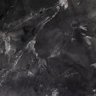 Rough and dark slate surface with cracks