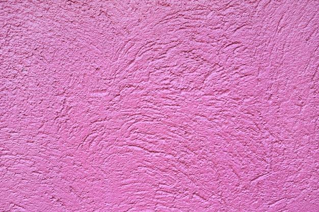 荒い深いピンクの壁の背景。