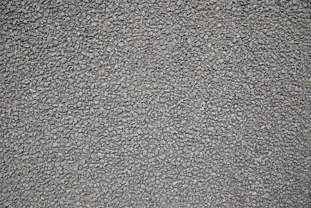 大まかな灰色のコンクリートの石の壁のテクスチャ背景、建物の外装