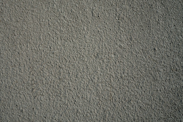 Rough gray painted plaster or stucco wall. abstract grunge background with copy space.