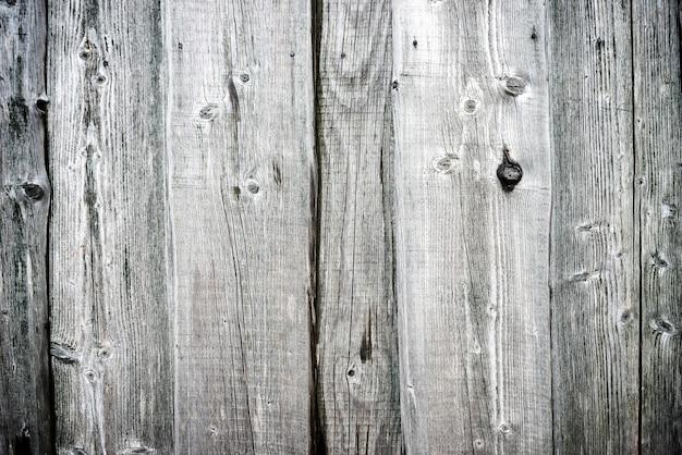 背景の粗い古い灰色の木の質感