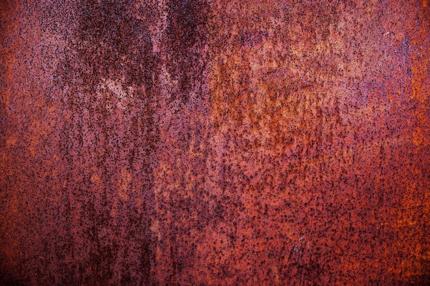 Rough orange rusty metal surface, abstract background.