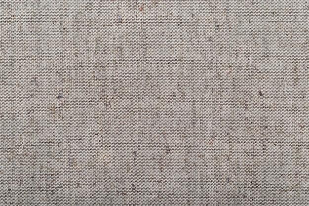 亜麻布の大まかな質感。閉じる。生地は天然成分で作られています。コットングレーの生地。