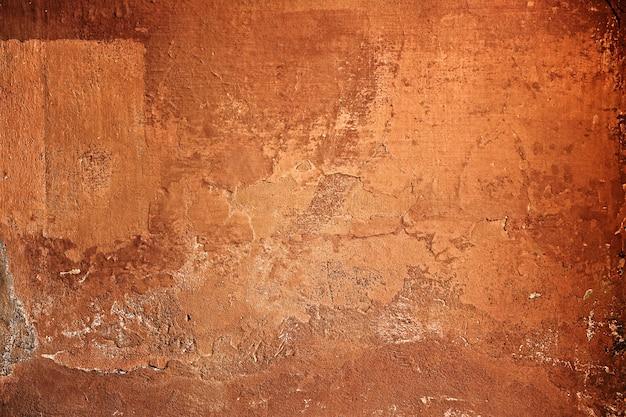Грубая текстурированная коричневая цементная стена