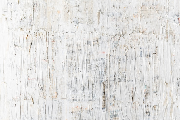 Rough white painted on newspaper wall. perfect for background. abstract  texture.