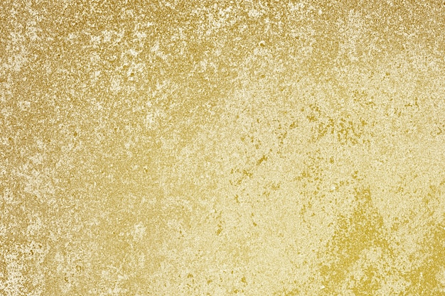 Roughly gold painted concrete wall surface background
