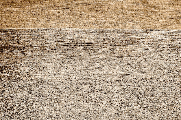 Roughly gold painted concrete wall surface