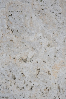 粗く加工された大理石の板。上面図。背景とテクスチャ。