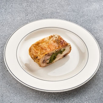 Roulade of chicken. chicken breast stuffed with herbs.