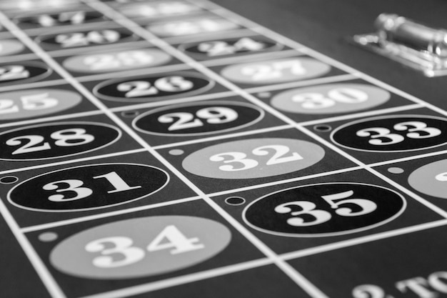 Roulette table in luxury casino. black and white photo