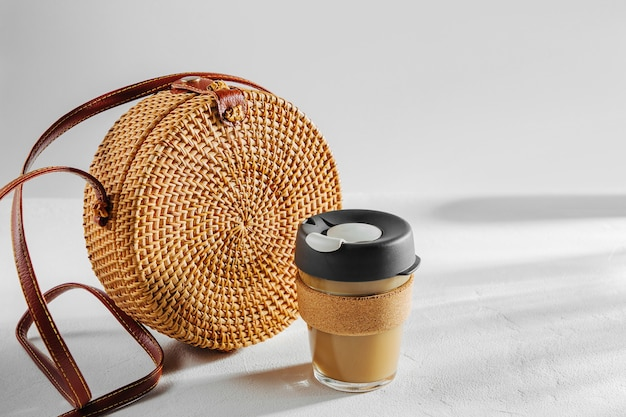 Round bamboo bag  with reusable coffee mug. sustainable lifestyle. zero waste, plastic free concept.
