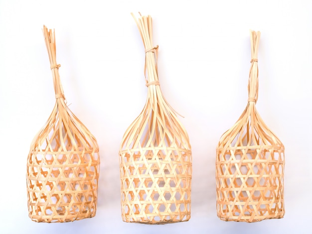 Round bamboo basket wicker craft of thailand isolated on white background.