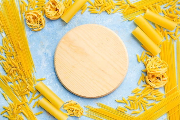 Round board with different pasta