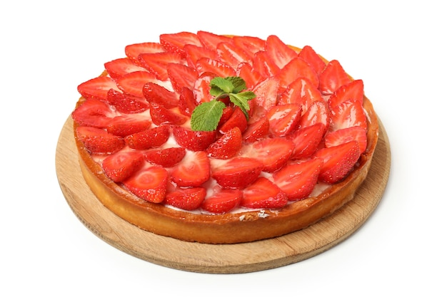 Round board with strawberry tart isolated on white background.