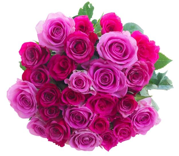 白い背景で隔離のピンクとマゼンタのバラの丸い花束