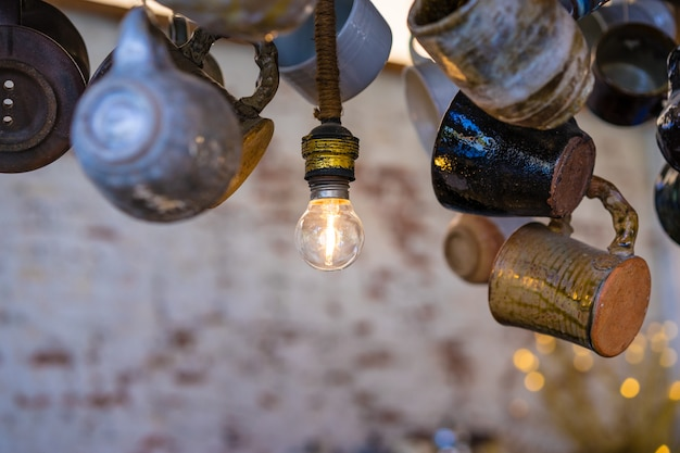 Round bulb on the ceiling with cup