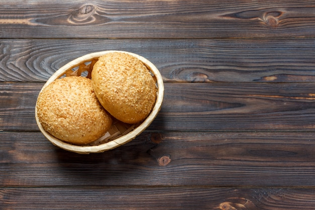 Round buns with seeds. bread in the basket. freshly baked bread rolls with seed
