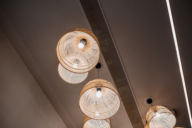 Round chandeliers hanging from ceiling