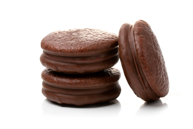Round chocolate cookies on a white background