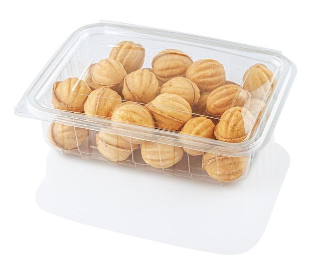 透明な食品容器に丸いクッキーナッツ